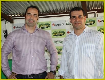 Daniel Cámara junto a Silvio de Souza directivos de Sidercol en ocasión de la inauguración y lanzamiento del nombre del frigorífico realizado en el marco de la primera edición de SaltOvino en el mes de agosto de 2012.