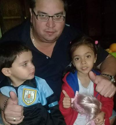 Luis Paccot y sus hijos